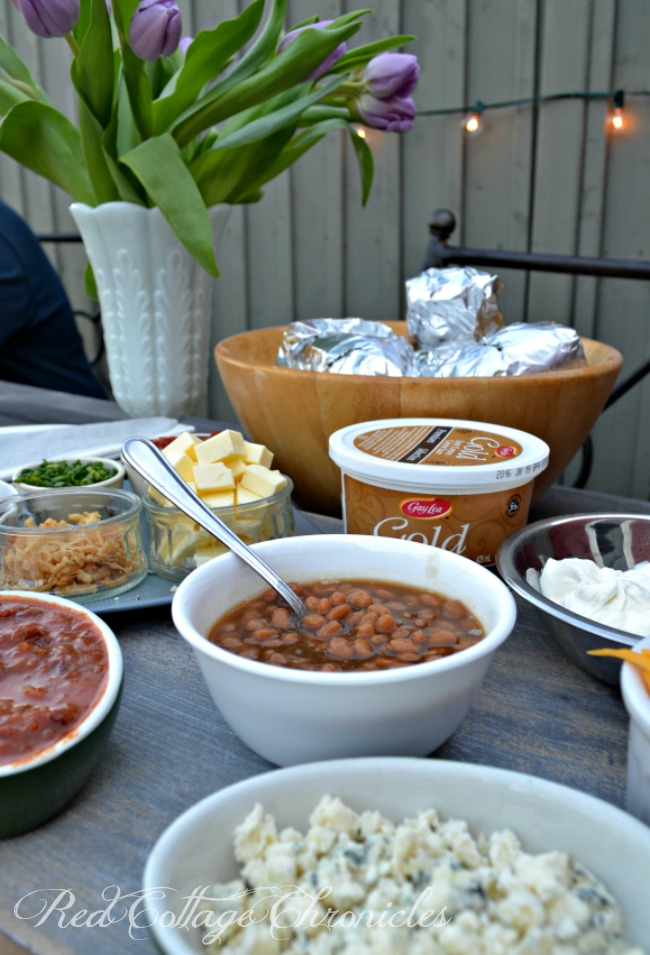 Why not set up a baked potato bar at your next barbecue