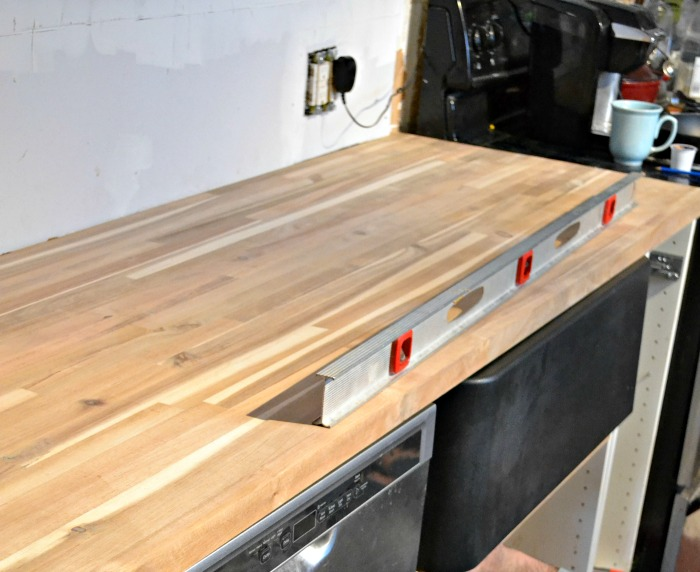butcher block counter and black farmhouse sink