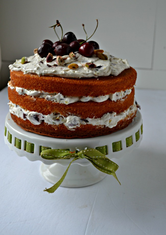 This Cherry Pistachio Naked Cake so delicious, you wouldn't guess it is so easy to make!