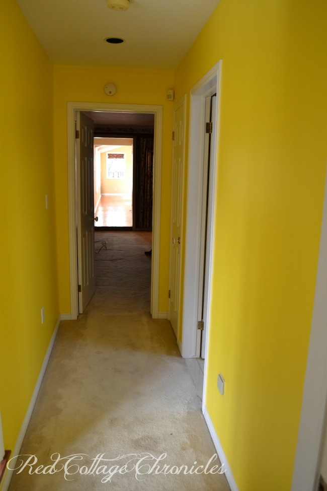 A fresh coat of paint tones down a previously bright yellow hallway