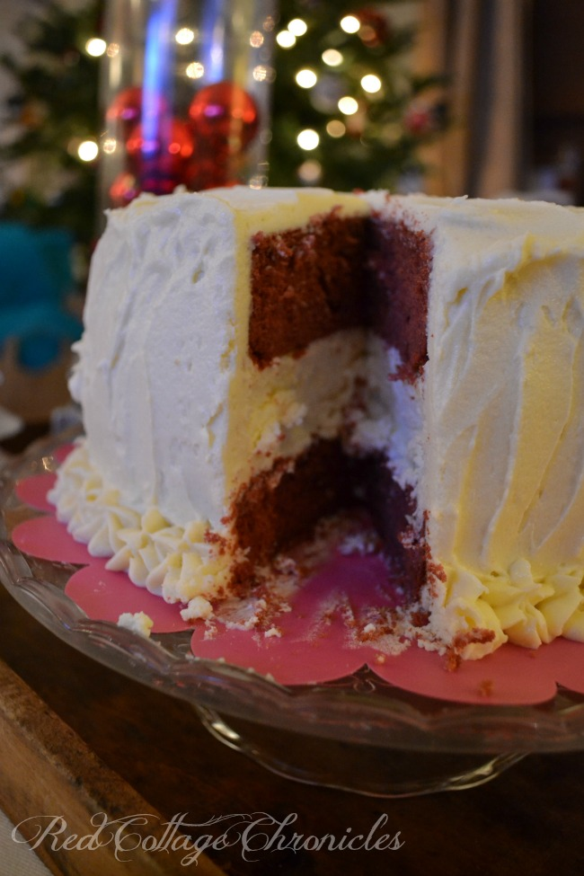 A decadent cheesecake layered between moist red velvet cake, all smothered in a buttercream frosting
