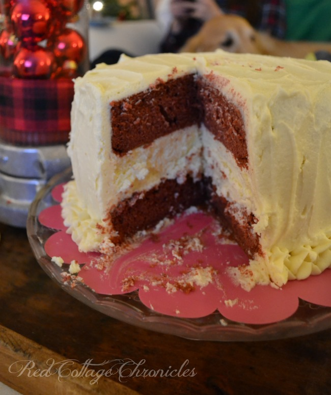 A decadent cheesecake layered between red velvet cake and smothered in a delicious buttercream frosting