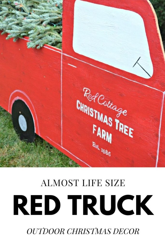 Almost life size red truck made from plywood. Perfect for outdoor Christmas decorating.