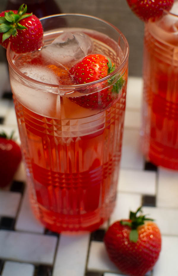 strawberry gin and tonic, a fruity twist on a classic cocktail