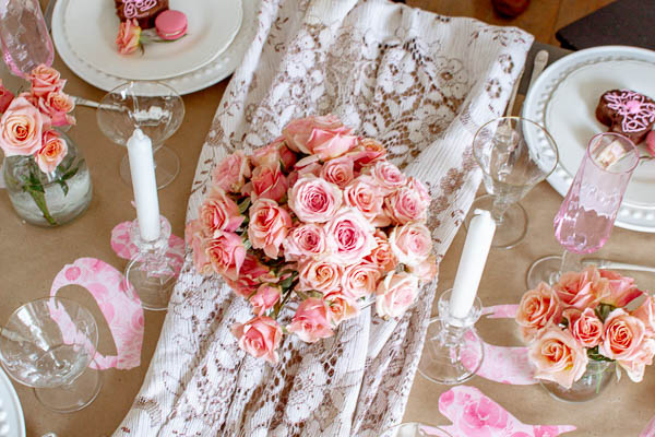 Vintage lace tablecloth highlights this Valentine's Day table decor