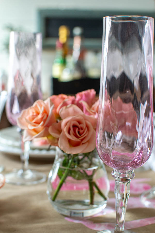Pink champagne flutes from Ikea are features of this Valentine's Day table decor