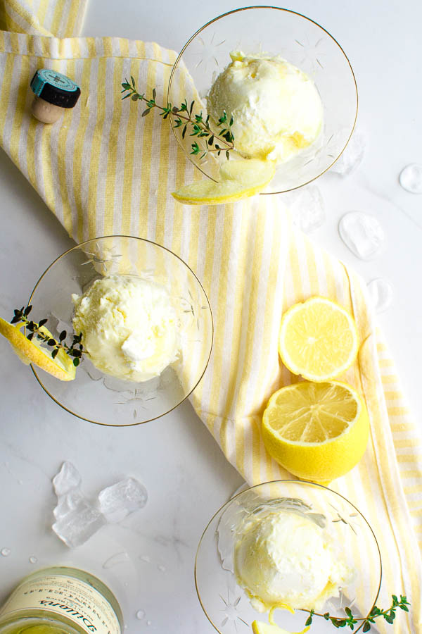 3 cocktail glasses filled with a frozen dessert made with whipping cream, limoncello and lemon curd