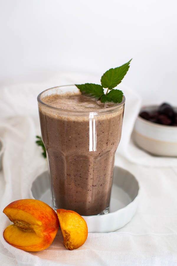 Fresh fruit smoothie with peaches, cherries and hemp powder