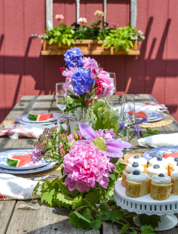 A brightly coloured summer table with fresh garden flowers