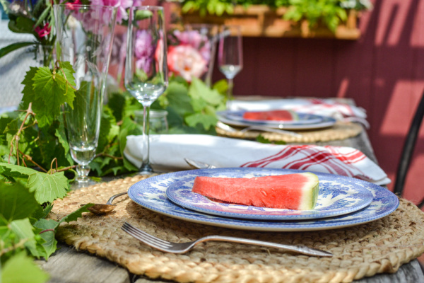 summer celebration tables cape with blue and white dishes and watermelon