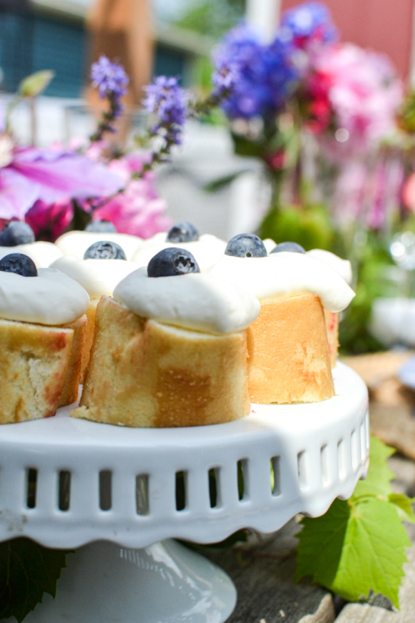 Rolled cake topped with whipped cream is a great summer dinner party idea