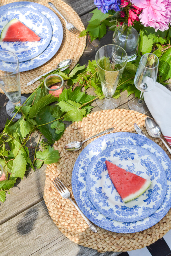 Watermelon top blue and white dinner plates for an outdoor dinner party