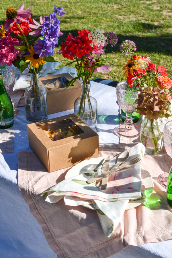 Boxed picnic lunch and flowers