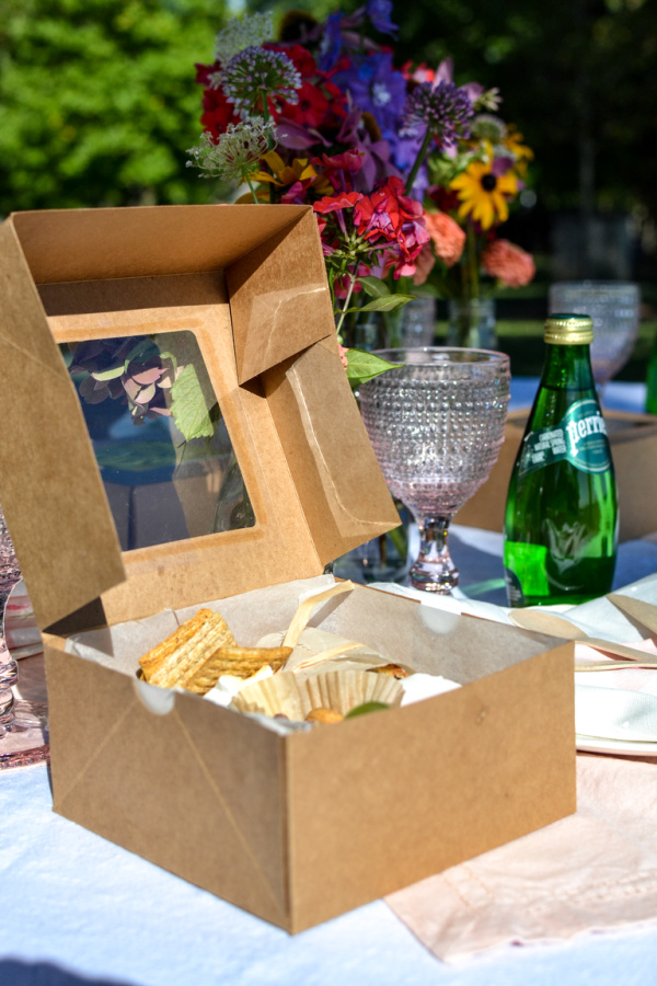Picnic by the lake with a boxed lunch