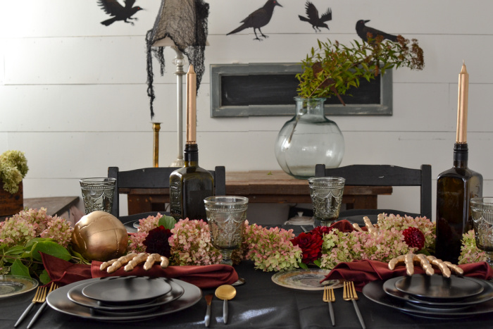 Halloween tablescape in black with burgundy and gold accents