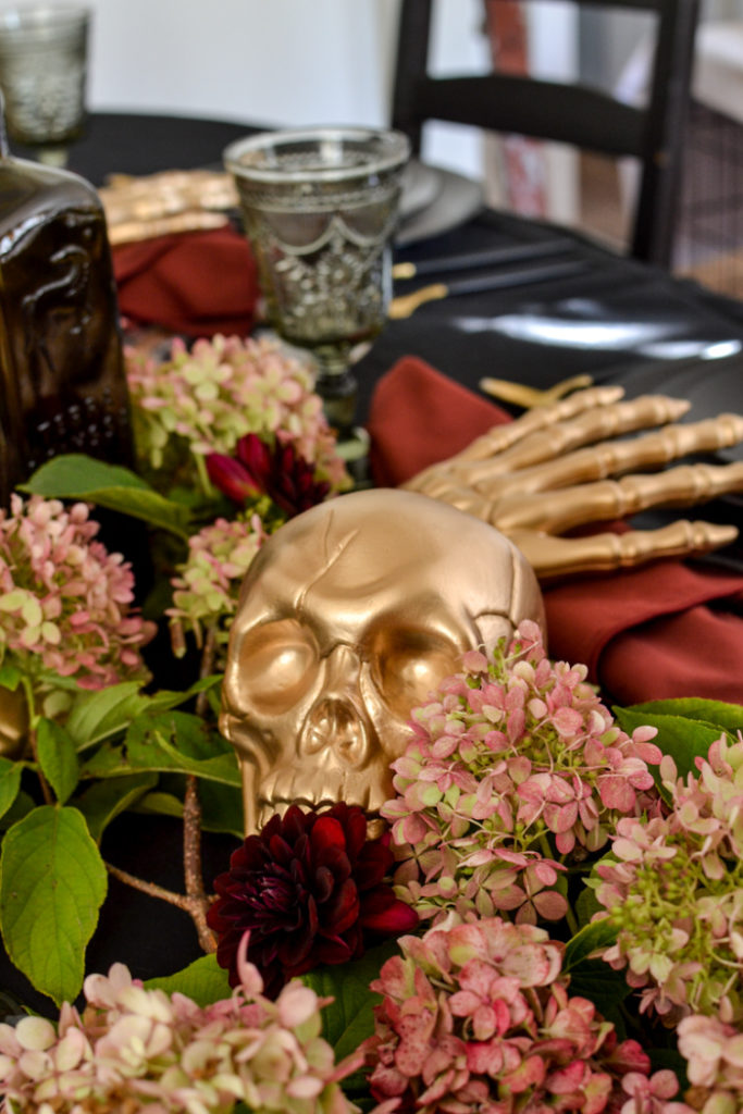 Gold skull centrepiece for a Halloween Tablescape