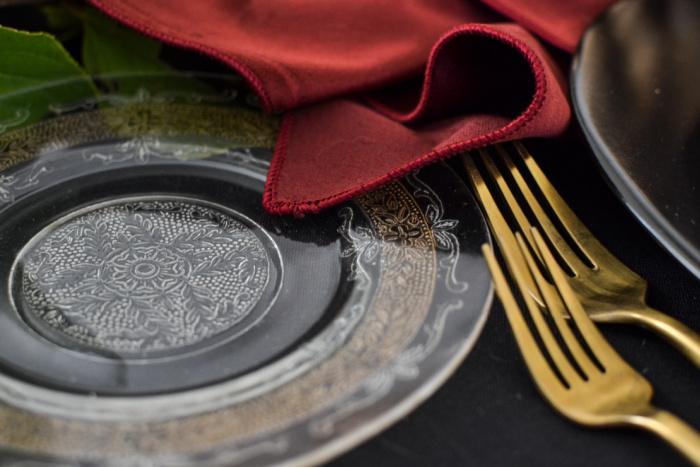 Gold embellished crystal plate on an elegant Halloween tablescape