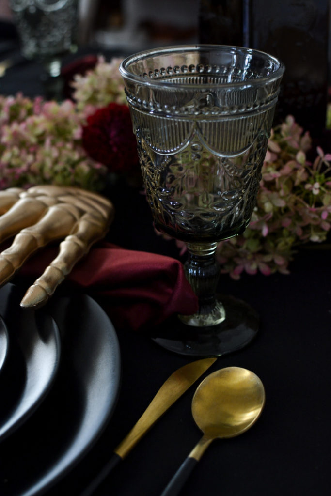 Smoke pressed glass water goblets on a Halloween table